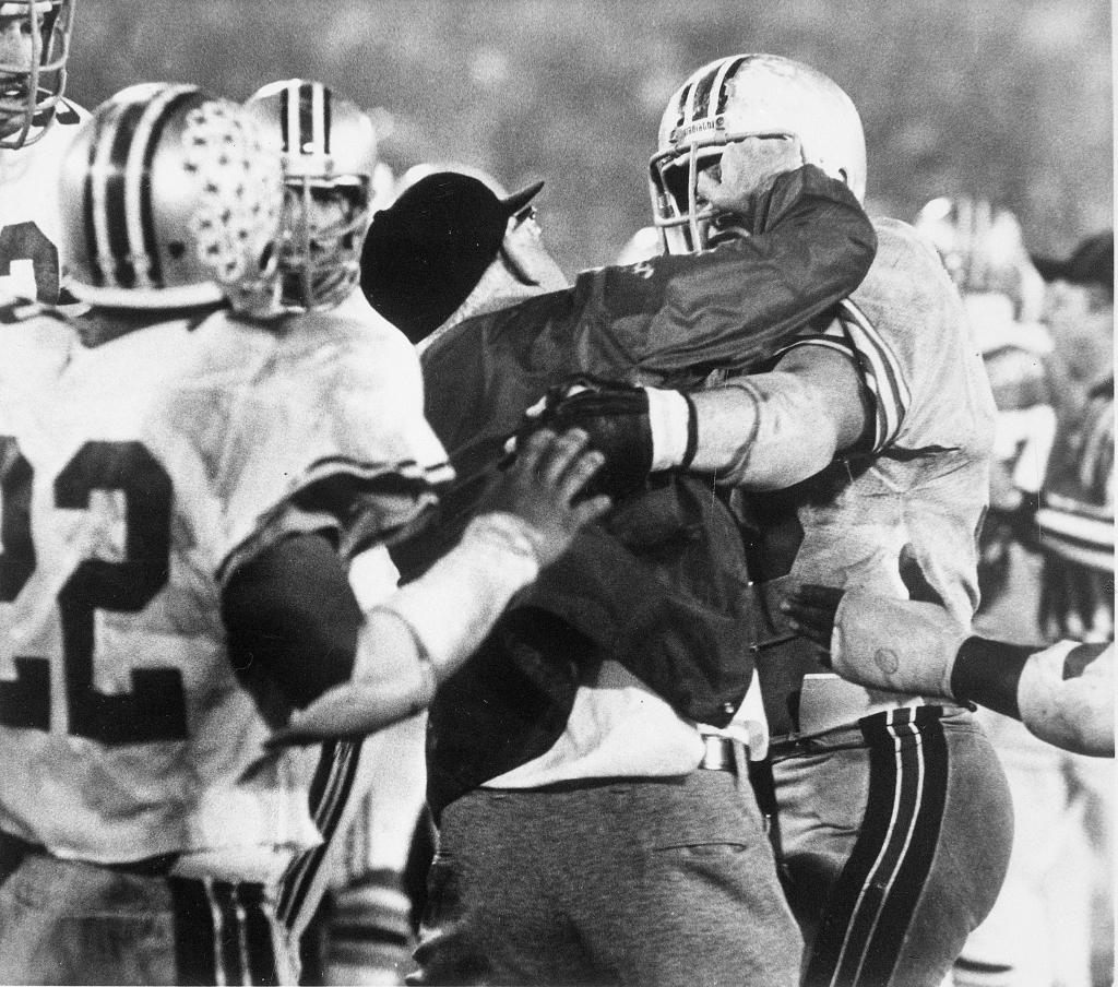 Coach Woody Hayes gets physical.